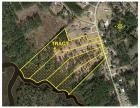TRACT 1: 8.5 +/- Acres WATERFRONT HOME SITE / MINI-FARM, 270+/- ft. frontage on Clubfoot Creek & 75 ft. on Adams Creek Rd. Conveys w/ Septic Permit