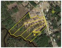TRACT 4: 5.0 +/- Acres WATERFRONT HOME SITE / MINI-FARM, 308+/- ft. frontage on Clubfoot Creek & 113 ft. on Adams Creek Rd. Conveys w/ Septic Permit