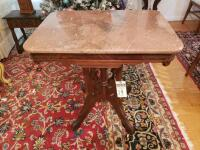 Victorian Pink/Rose Marble Top Table Carved Rectangular Walnut Center Table, Circa 1890. Features a Beveled Marble Top Surmounting Carved Walnut Base.