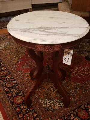 Antique Marble Oval Top Table, circa 1890. Features a Beveled Marble Oval Top Surmounting Carved Walnut Base with Four Legs Seated on Casters.