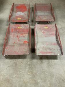Four Red Automotive Dolly or Tire Skates In Good Working Order
