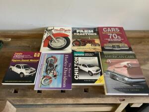 Seven (7) Books; Two Toyota Repair Manuals, and Five Coffee Table Books About Motorcycles To Tractors to Vintage Cars