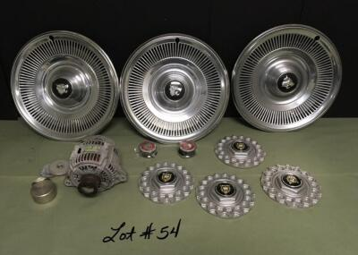 "Twelve (12) Parts; 4 JAGUAR 2.25"" Center Wheel Covers, 4 JAGUAR 6.25"" Hub Cap Covers, JAGUAR Alternator Unknown Working Condition, & Three Wheel Skins"
