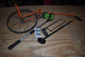 two measuring wheels, telescoping magnet, hack saw, PLEASE VIEW ALL PHOTOS