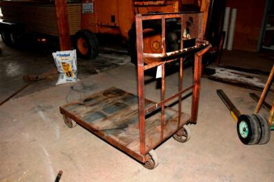 early 1900's Warehouse / Feed Store style 4 wheel Cart, with steel wheels and oak platform. Heavy Duty steel wheels with rubber type covering