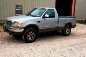 2002 FORD F150XLT Pickup Truck, TRITON V-8, 4WD, showing 176,347 miles, Starts Good & Operational, but Transmission will NOT shift above 2nd gear. VIN 1FTRF18W02NB95091