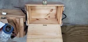 two wood storage boxes and contents