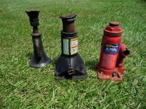 One Red 4 Ton Pro Lift Hydraulic Jack; One 8 Ton Bottle Jack Black Hydraulic Jack; AND One Jack Stand 1X6