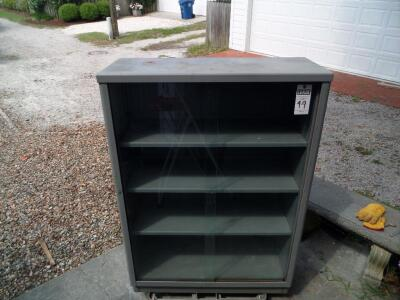 Vintage Tanker Bookcase with Glass Doors - Measurements: 37 in. x 53 in. x 15 in. Adjustable interior shelves Tempered glass front doors