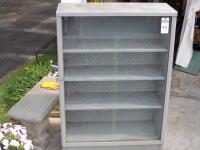 Vintage Tanker Bookcase with Glass Doors - Measurements: 37 in. x 53 in. x 15 in. Adjustable interior shelves Tempered glass front doors - 3