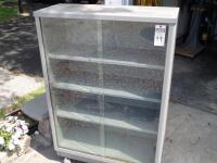 Vintage Tanker Bookcase with Glass Doors - Measurements: 37 in. x 53 in. x 15 in. Adjustable interior shelves Tempered glass front doors - 12