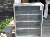 Vintage Tanker Bookcase with Glass Doors - Measurements: 37 in. x 53 in. x 15 in. Adjustable interior shelves Tempered glass front doors - 14