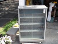 Vintage Tanker Bookcase with Glass Doors - Measurements: 37 in. x 53 in. x 15 in. Adjustable interior shelves Tempered glass front doors - 15