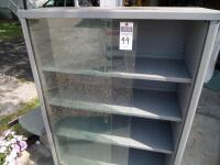 Vintage Tanker Bookcase with Glass Doors - Measurements: 37 in. x 53 in. x 15 in. Adjustable interior shelves Tempered glass front doors - 16