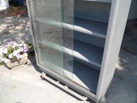 Vintage Tanker Bookcase with Glass Doors - Measurements: 37 in. x 53 in. x 15 in. Adjustable interior shelves Tempered glass front doors - 18