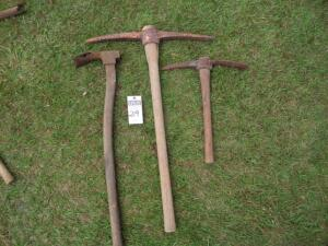 Two (2) Pick-Axes & one (1) Vintage Adze - Approx. lengths are 36 in., 33 in., & 20 in.