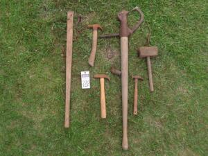 9 Vintage Farming Tools including 3 hooks; Wooden Tie Pole; Log Pull; Wooden Hammer; and 3 Hammers. SEE ALL PHOTOS FOR MEASUREMENTS