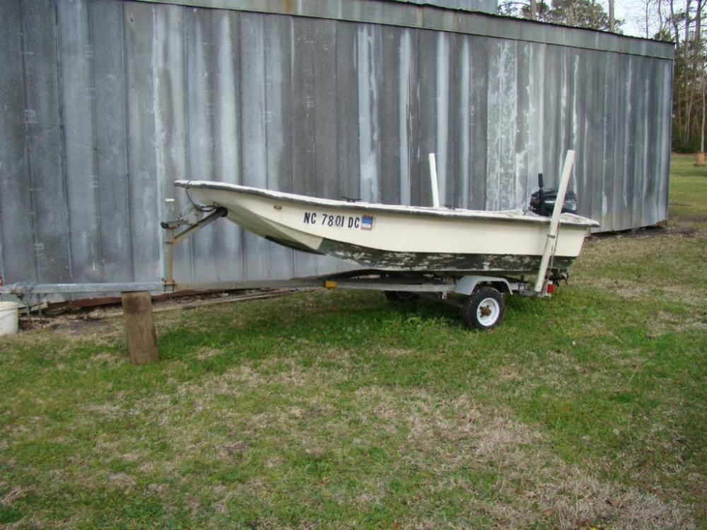 12 foot CAROLINA SKIMMER skiff with 15 HP MERCURY Outboard